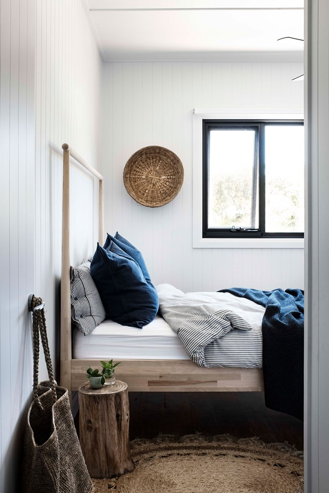 """Rich navy bed linen connects this bedroom to the view of Lake Conjola beyond. In this newly built [modern barn house](https://www.homestolove.com.au/modern-barn-style-house-19961