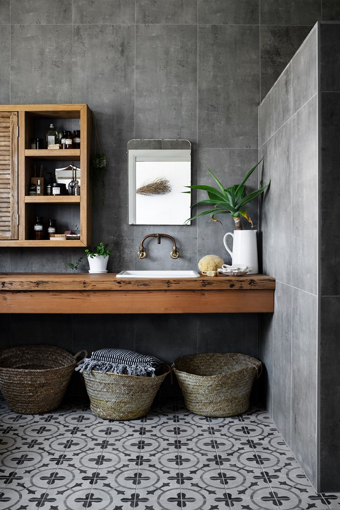 In the bathroom, both the wall and floor tiles are from Premier Coast Tiles in Ulladulla. The Oregon timber vanity was crafted by David and features an inset IKEA sink.