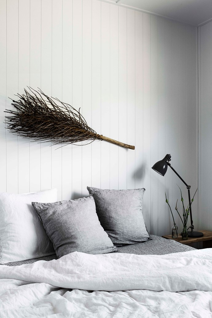 "A touch of nature in the form of a dried frond creates a focal point above the bed in the main bedroom. The bed is dressed in linen from I Love Linen while the Aröd lamp is from [IKEA](https://fave.co/2WB5umw|target=""_blank""