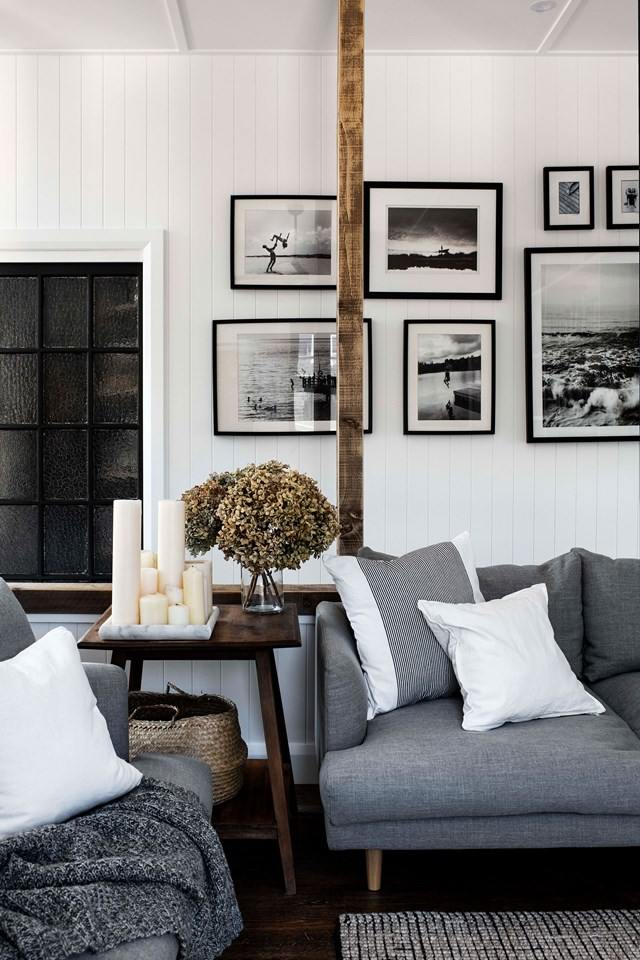 "Black-and-white photographs, hung in a saloon style, adorn the walls of this [modern barn house](https://www.homestolove.com.au/modern-barn-style-house-19961|target=""_blank""). A monochromatic palette creates a sense of calm."