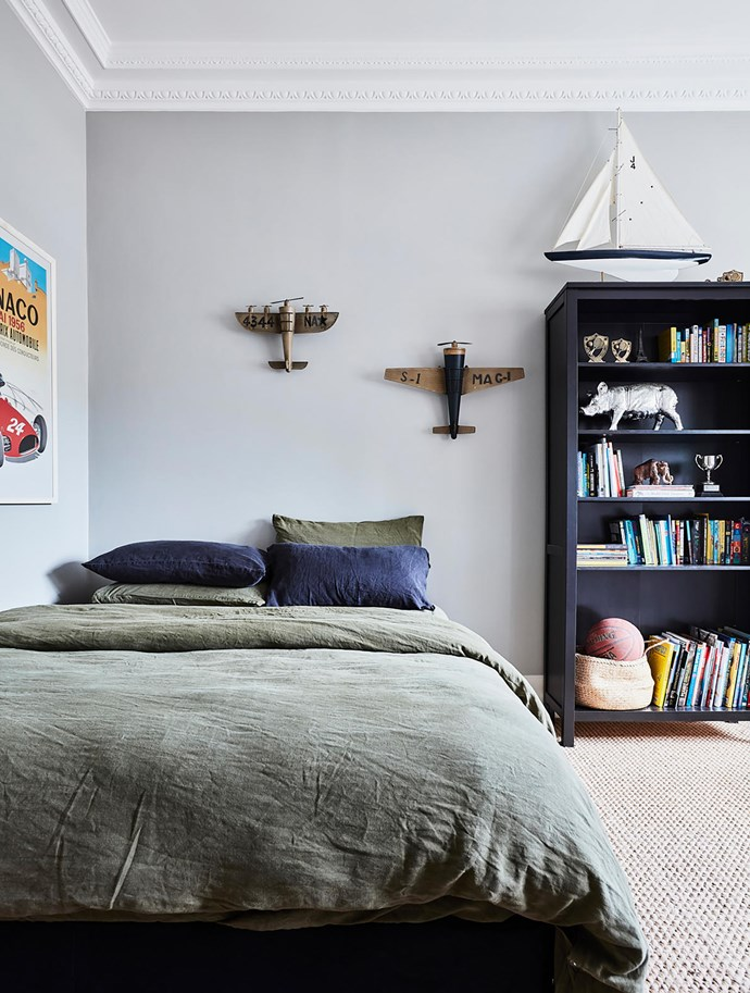 Rich tones of green and black complement Luke's fine collection of fun objects. Blue pillowcases, Città. Bookcase, Ikea. Smart buy: Flax linen bedding in Olive, $270/queen size, Bed Threads.