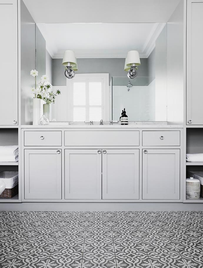 A soothing neutral scheme is the hallmark of all the bathrooms in the home. MDF custom wainscoting painted Dulux Natural White Half. Other wall sections and cabinets in Dulux Naval Grey Quarter. Neu England tapware and Ambience heated towel rail, Brodware. Door hardware and Lugarno sconces, Restoration Hardware (US). Amity Grey cement floor tiles, Teranova.