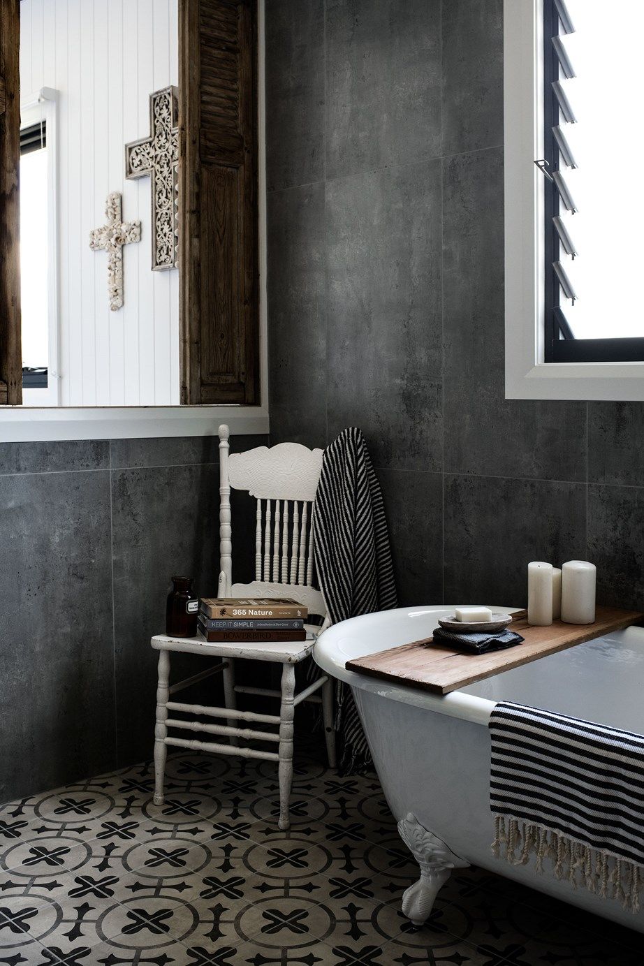 Rustic timber finishes combined with a freestanding bath create an authentic farmhouse feel in this bathroom. The higher the ceilings, the more spacious and barn-like a room feels.