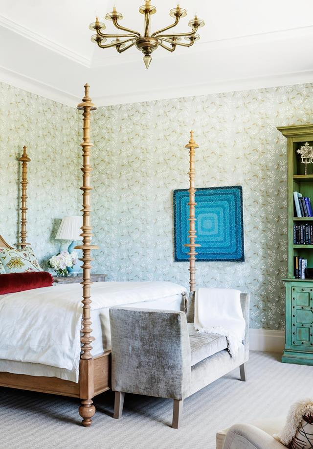 "The owners of this [Melbourne home](https://www.homestolove.com.au/historic-home-revamp-19835|target=""_blank"") commissioned the late Stuart Rattle and then Thomas Hamel to work their magic room by room. The main bedroom features GP & J Baker Crayford 'Apple Blossom' wallpaper from Elliott Clarke. *Photograph*: Matt Lowden. From *Belle* April 2019."
