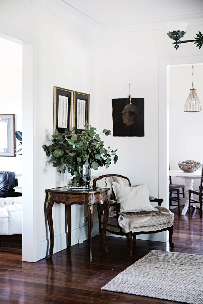 """In the sitting room, the Louis chair is one of a set that Heidi had made for her previous home, while the French portrait is from [China Squirrel](http://chinasquirrel.com.au/