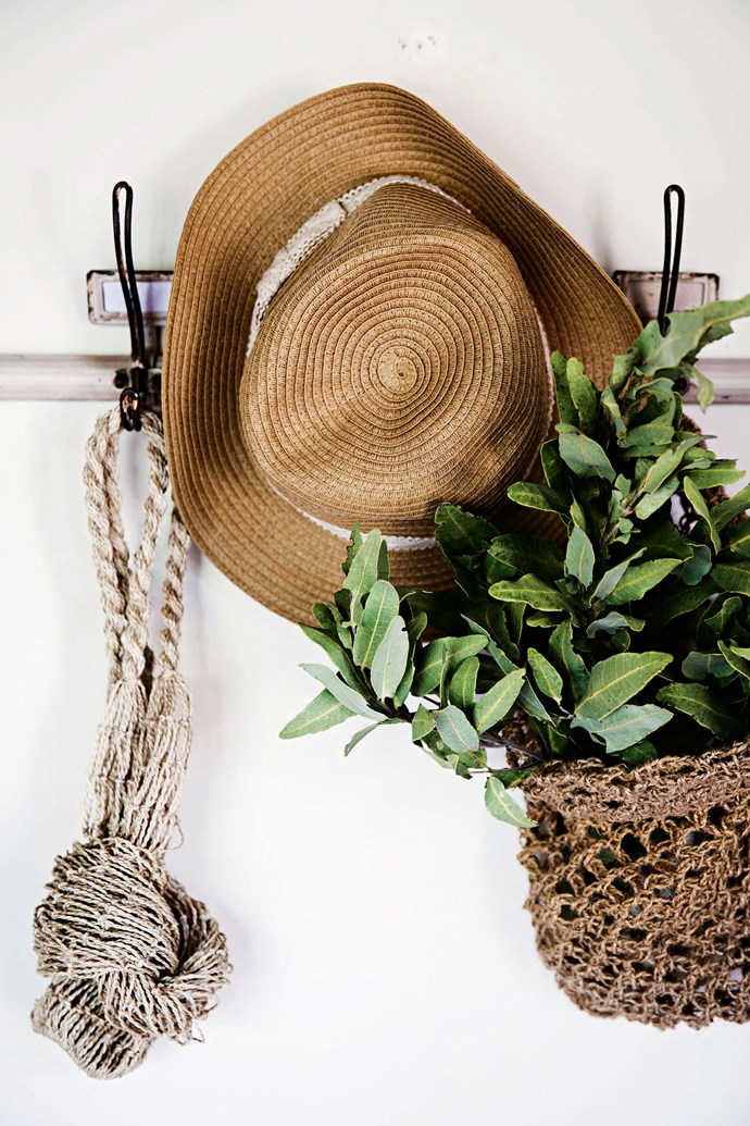 """Enthusiastic decorator Heidi O'Rourke crocheted the bag filled with foraged eucalyptus foliage. The hat rack, near the entrance to the kitchen, is from [Early Settler](https://www.earlysettler.com.au/