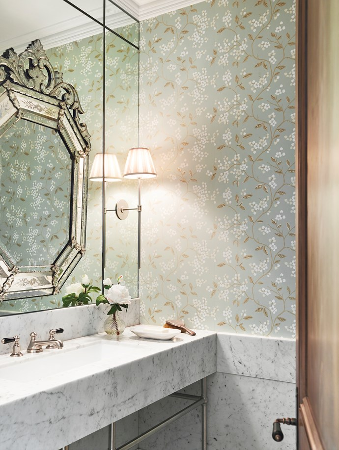 Pale sage and floral patterns deliver a freshness and sense of romance to this ensuite bathroom designed by Thomas Hamel & Associates. GP & J Baker 'Crayford' wallpaper from Elliott Clarke.  *Photograph*: Anson Smart. From *Belle* December/January 2017/18.