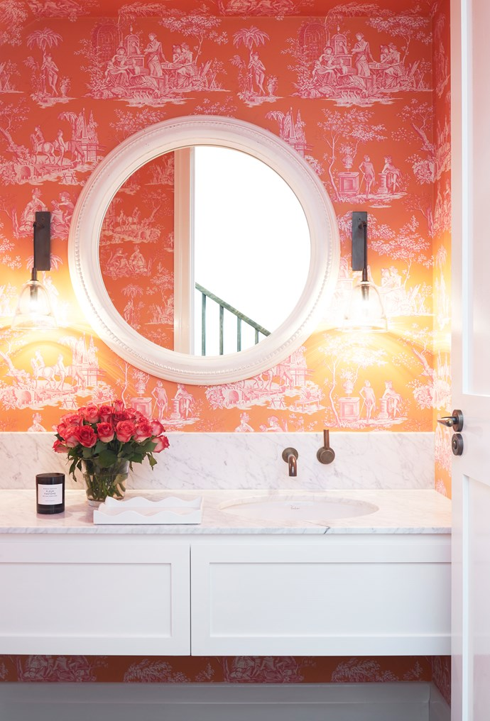 As this bathroom is small and has a low ceiling, Designer Alexandra Brownlow used the beautiful Manuel Canovas 'Balleroy' wallpaper on the walls and ceiling for warmth and to draw people into the space. *Photograph*: Christine Francis. From *Belle* April 2018.