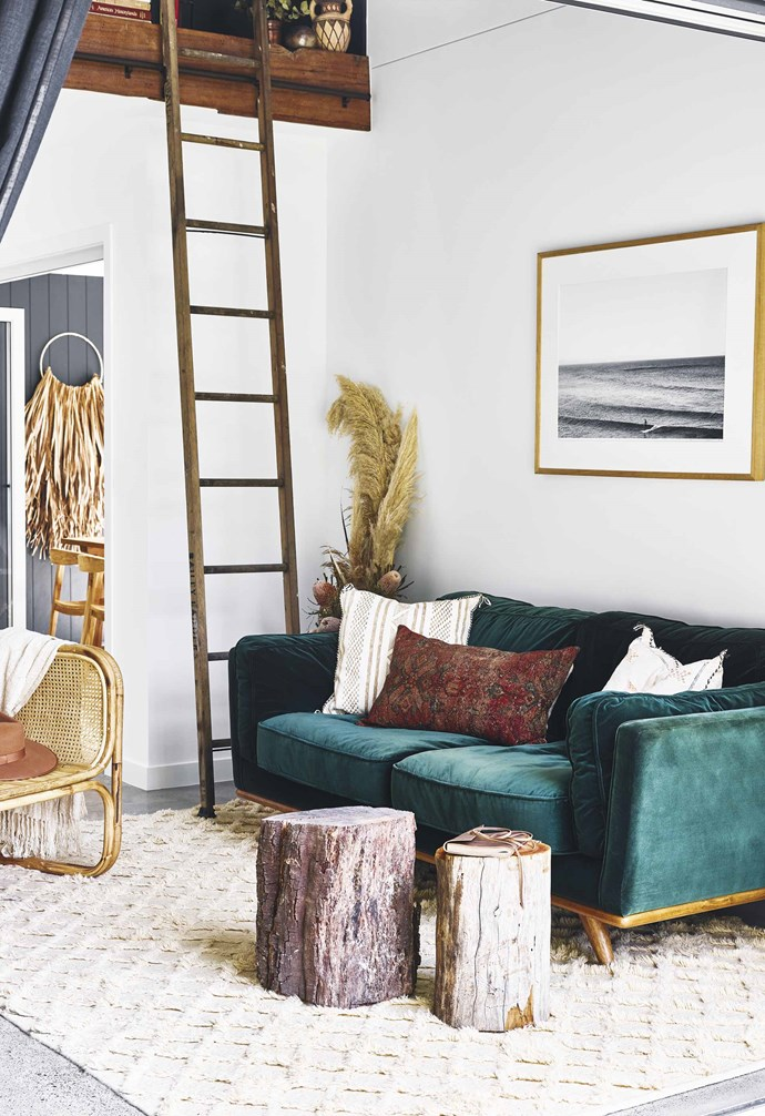 """**Rug it up** The speckled polished concrete floor has been paired with warm rugs in this [chic Queensland pool house](https://www.homestolove.com.au/pool-house-19517 Target=""""_Blank""""). *Styling: Hayley Jenkin   Photogrpahy: Toby Scott*."""