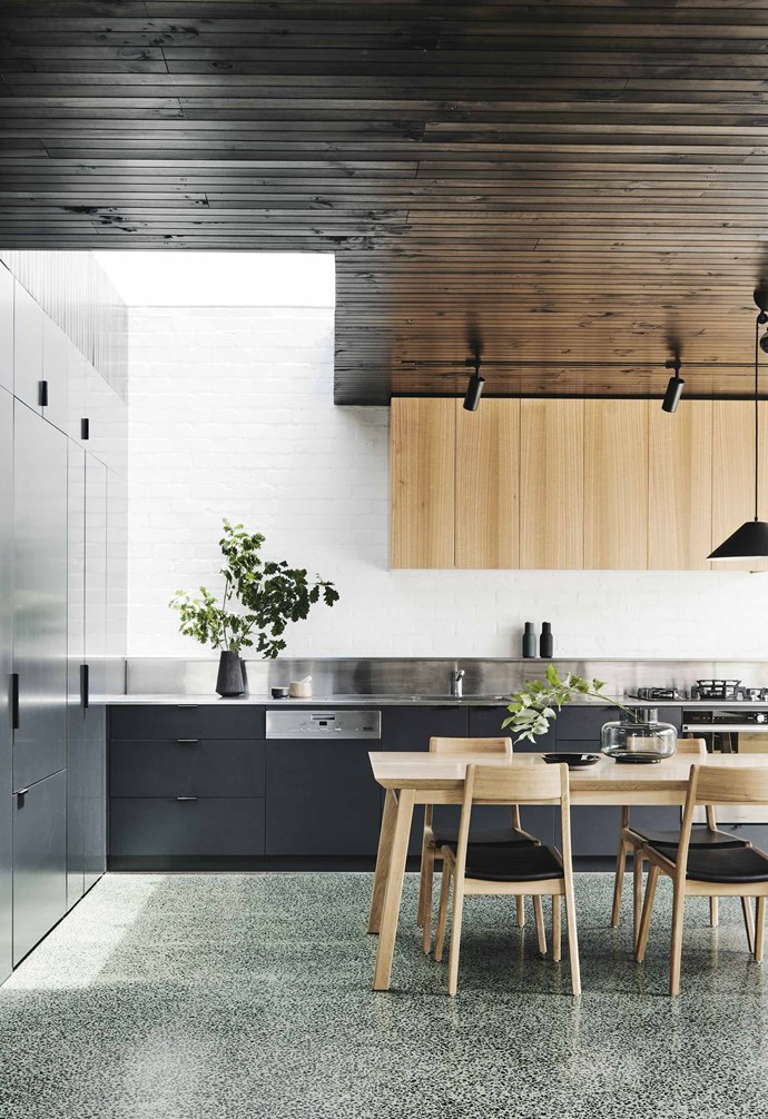 """**Green dream** Sage-green concrete is mixed with local bluestone to make the striking terrazzo flooring in this Melbourne home by Taylor Knights Architecture & Interior Design. The cabinetry, in Dulux Domino, picks up on the colour of the bluestone. *Design: [Taylor Knights Architecture & Design](http://taylorknights.com.au/ target=""""_blank"""" rel=""""nofollow"""")   Photography: Tom Blachford*."""