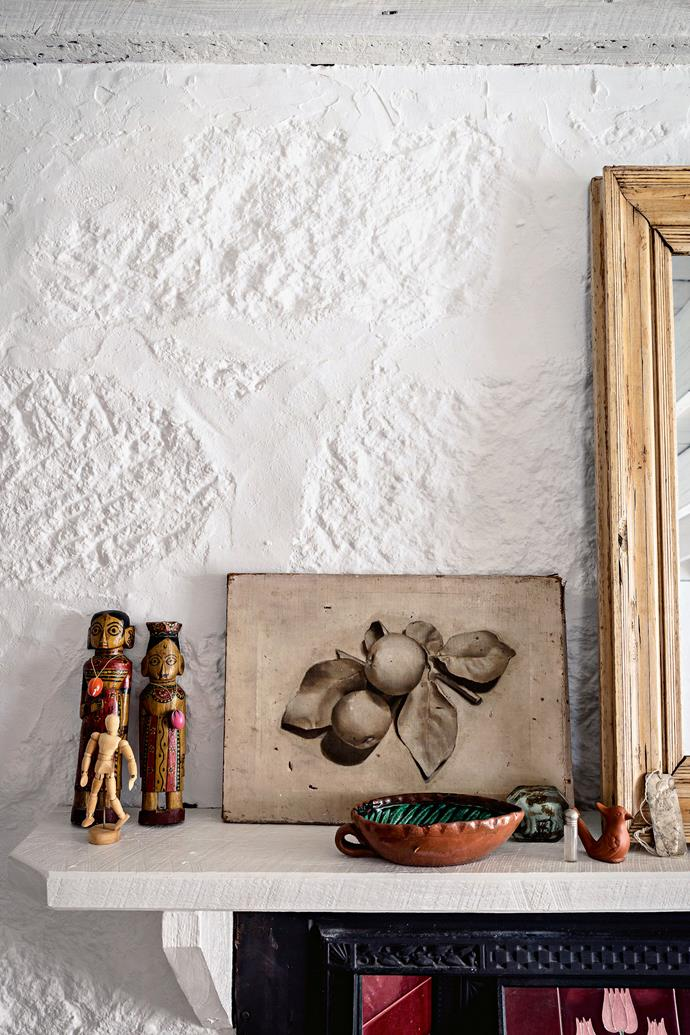 A print inherited from Kate's great-aunt, artist Janna Bruce sits on a mantelpiece.
