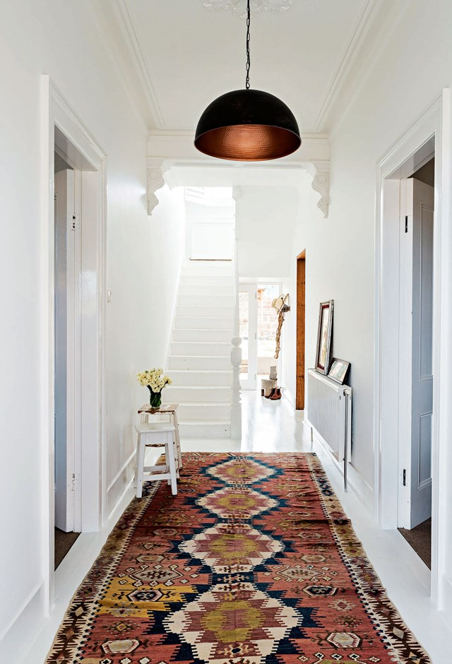A colourful Kilm hallway runner brings this simple white entryway to life while leading the way from the front door to the central living spaces.