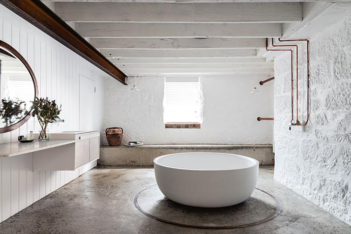 Located on the ground floor, the main bathroom has the feel of a modern hammam thanks to its low timber ceiling, concrete floor and painted stone walls. The Fienza cast stone 'Shinto' bath was sourced locally from South East Tile & Bathroom Centre.