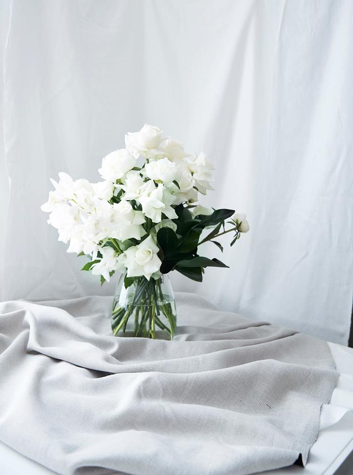 """""""If you're wanting to start arranging your flowers yourself, a bell or dome style vase – anything smaller at the top and wider at the bottom – is easy to work with,"""" Georgia says."""