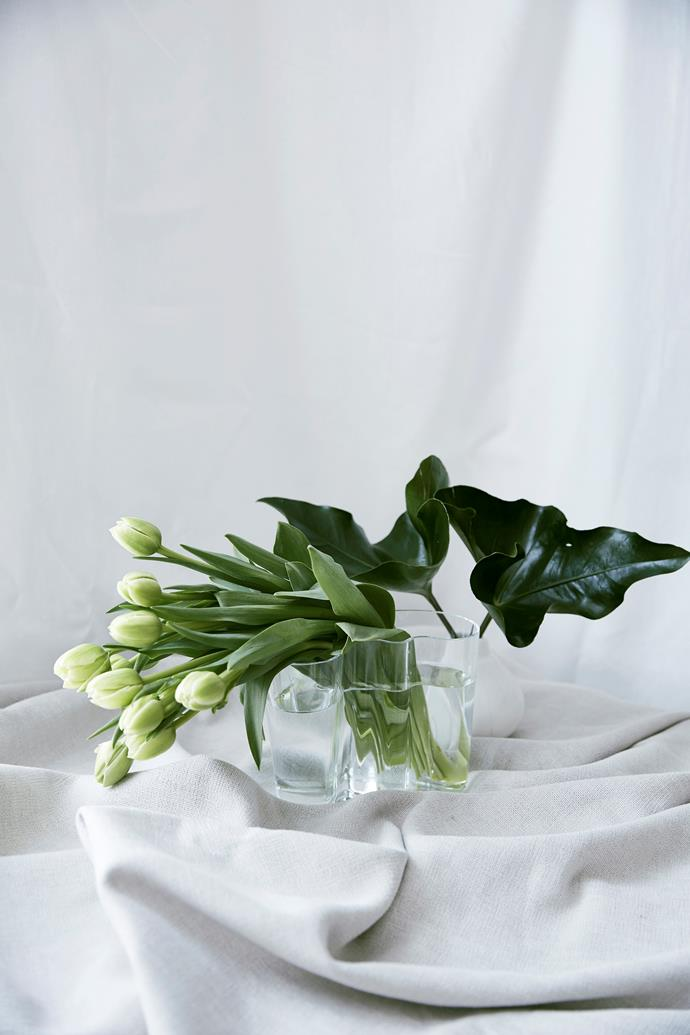 """Use foliage from the garden to fill out your arrangements. """"Deep green arrow leaves are a favourite of ours,"""" Georgia says."""
