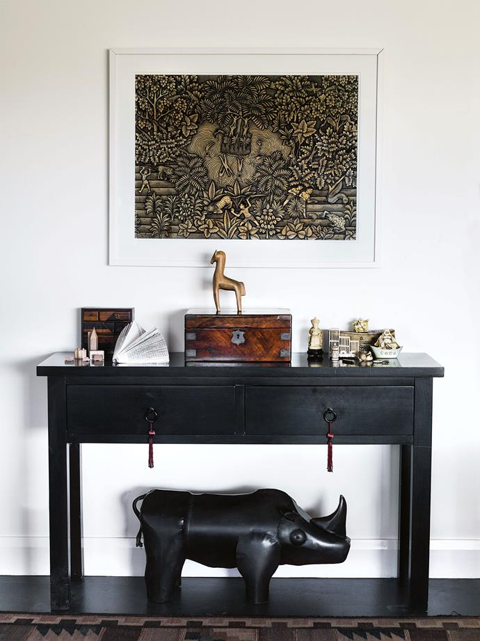 Treasured objets d'art are arranged to suit Barbara's eclectic eye. The gouache artwork is by a Balinese artist named Ida Bagus Rai.