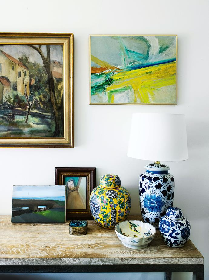 Paintings by Desiderius Orban (top left) and Tim Littlemore (top right and in the small wooden frame) are grouped with ginger jars and sundry treasures, including a painting (bottom left) Barbara bought for $2 in an op shop.