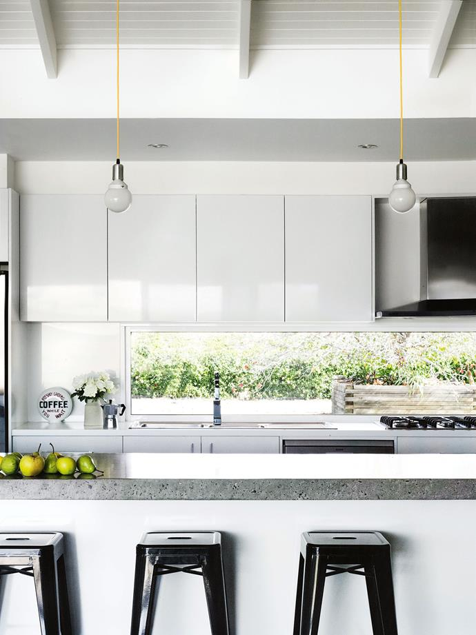 A three-metre-long concrete bench is the centrepiece of the kitchen.