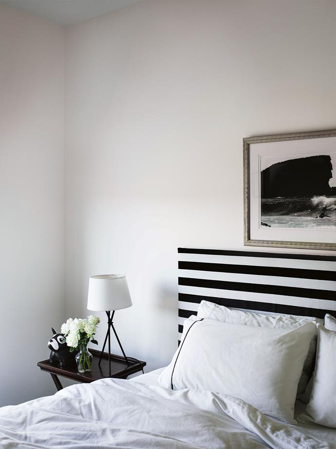 The guest bedroom in simple black and white.
