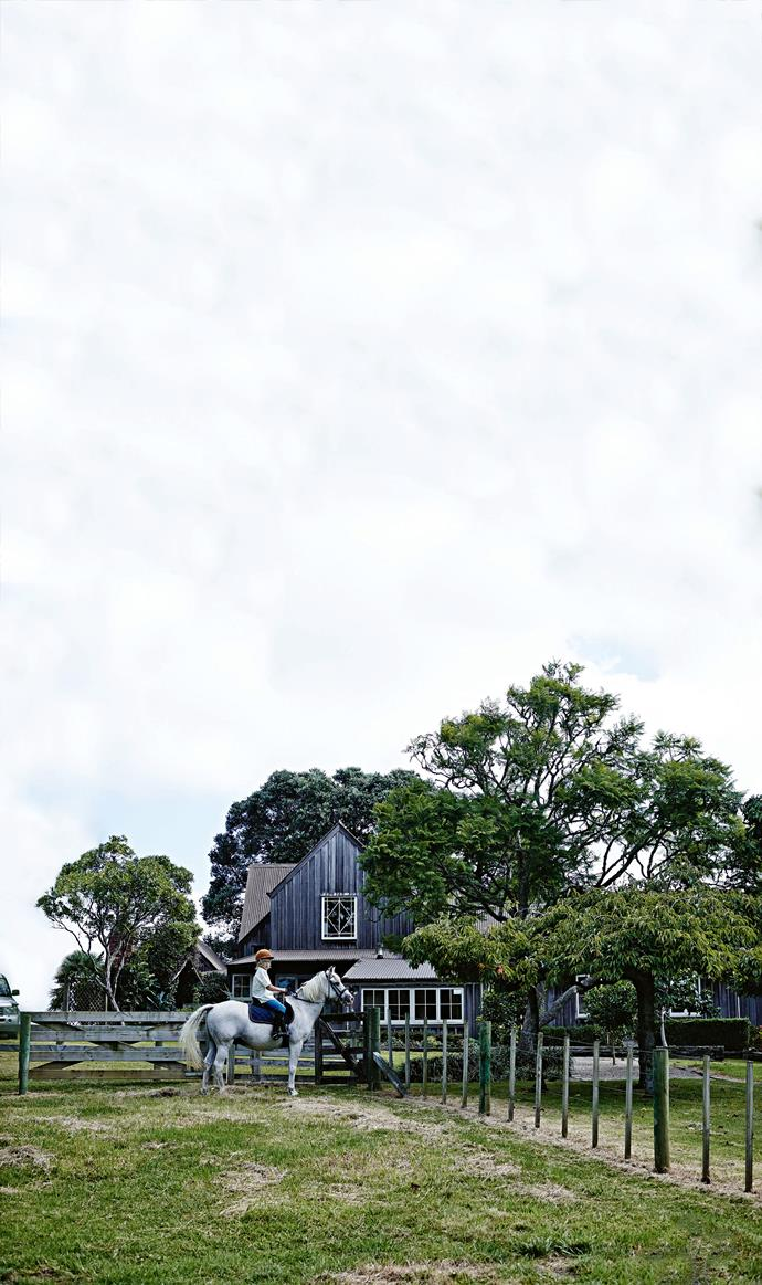 "The [contemporary farmhouse](https://www.homestolove.com.au/a-guide-to-modern-country-style-1944|target=""_blank"") showcases the ""new colonial"" style of 1975. That is, pitched roofs, exposed beams and split-level wooden floors. Here, Mel and Jacks' son Spike heads off for a ride."