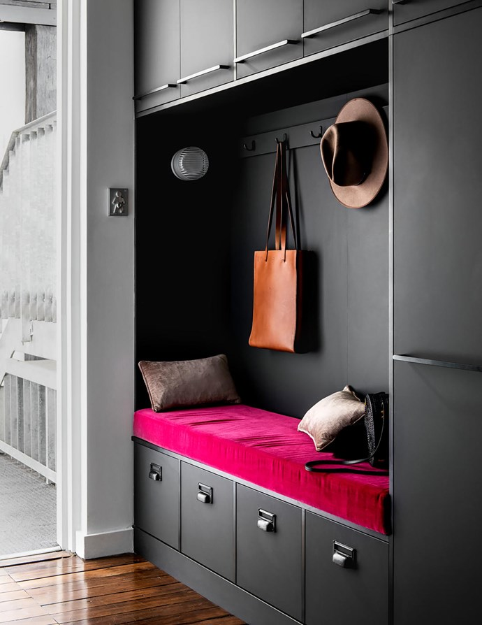 Next to the door is this hat rack and bench in a 'fingerprint-proof' laminate called Traceless in Black by Wilsonart.