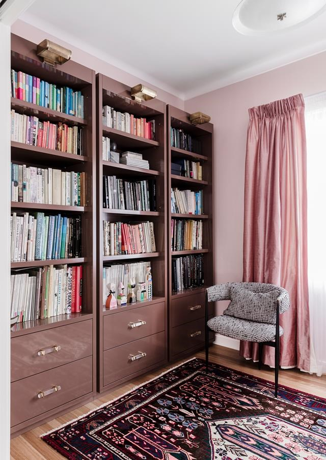 "The [library walls](https://www.homestolove.com.au/art-deco-style-honoured-in-renovation-of-newcastle-home-6661|target=""_blank"") have been coated in the shade 'Petite Pink' by Dulux. Repeat variations of one colour (in this case pink), make for visual continuity. *Photograph*: Maree Homer"