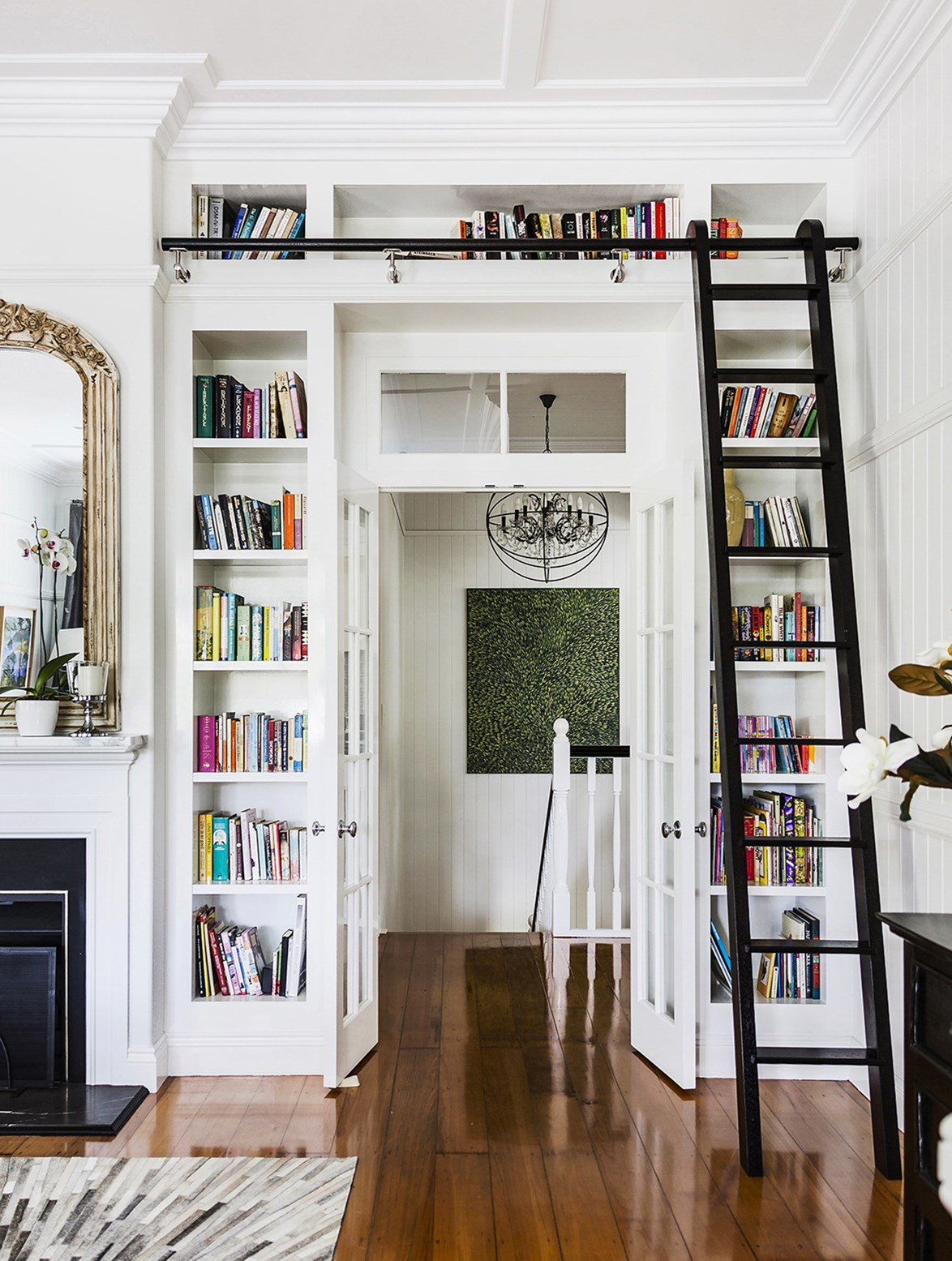 A ladder is practical and decorative addition in this home library.