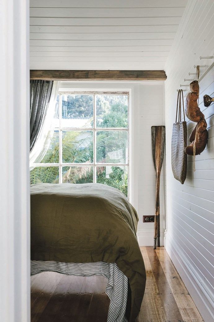 The bedroom, like the rest of the cottage, has been painted white and features polished Tasmanian oak floors.