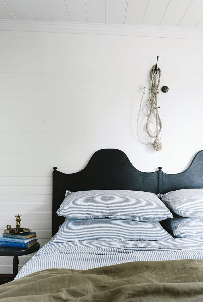 """The striped bed linen is by Bedtonic. Sarah made the eye-catching bed by cleverly joining two bedheads that were originally made for twin boys (their names are still on the back of the bedheads). The rope is a monkey's fist knot entwined with a light fitting from [Duckfat](https://duckfat.myshopify.com/