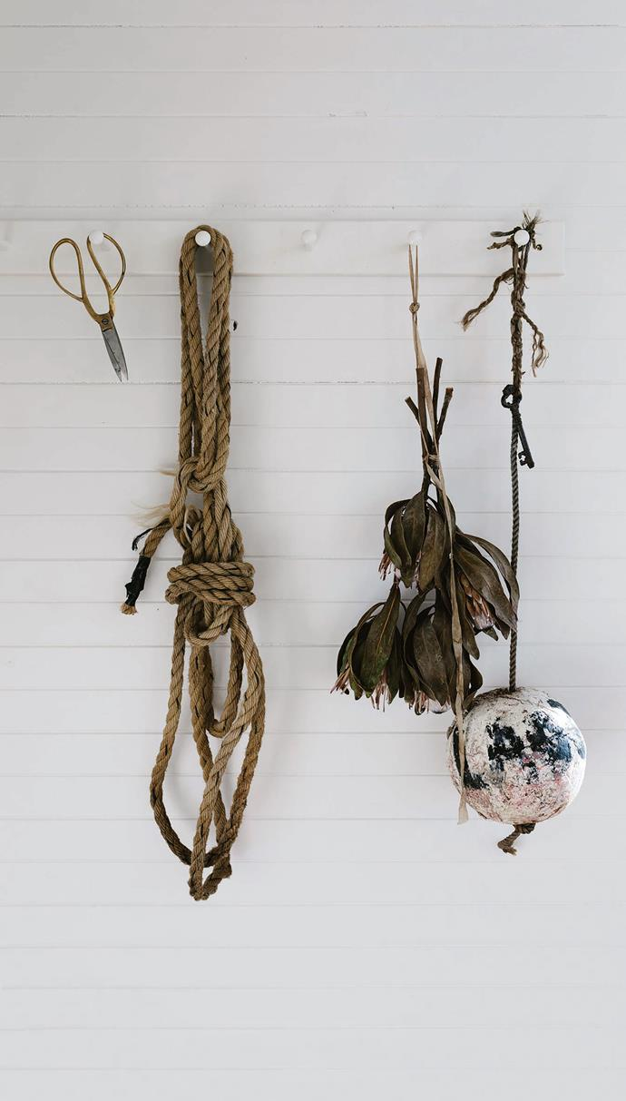 Sarah is an adventurer who is prone to spontaneous decisions — buying a run-down cottage thousands of kilometres from where she was born and raised in Geraldton, Western Australia, is just the latest one. Old rope and assorted objects hang against a wall.