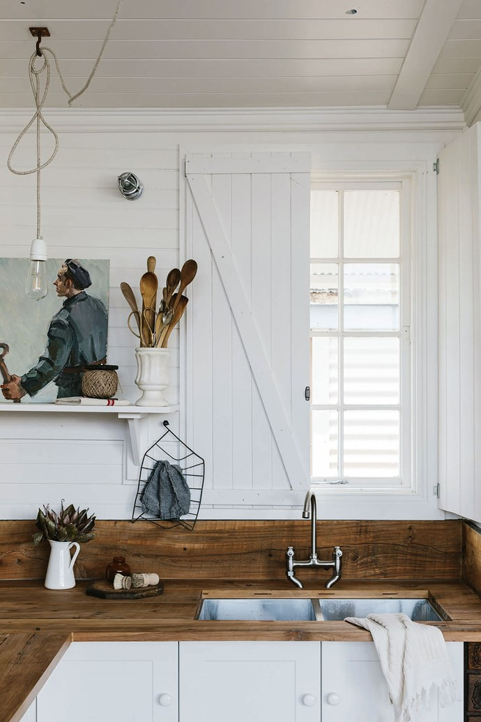 """In the kitchen, the painted wooden shutters can be closed to keep out the wild weather that sometimes lashes this remote coastal area. """"We have snow, mist and lots of rain; the landscape is always changing,"""" says Sarah."""