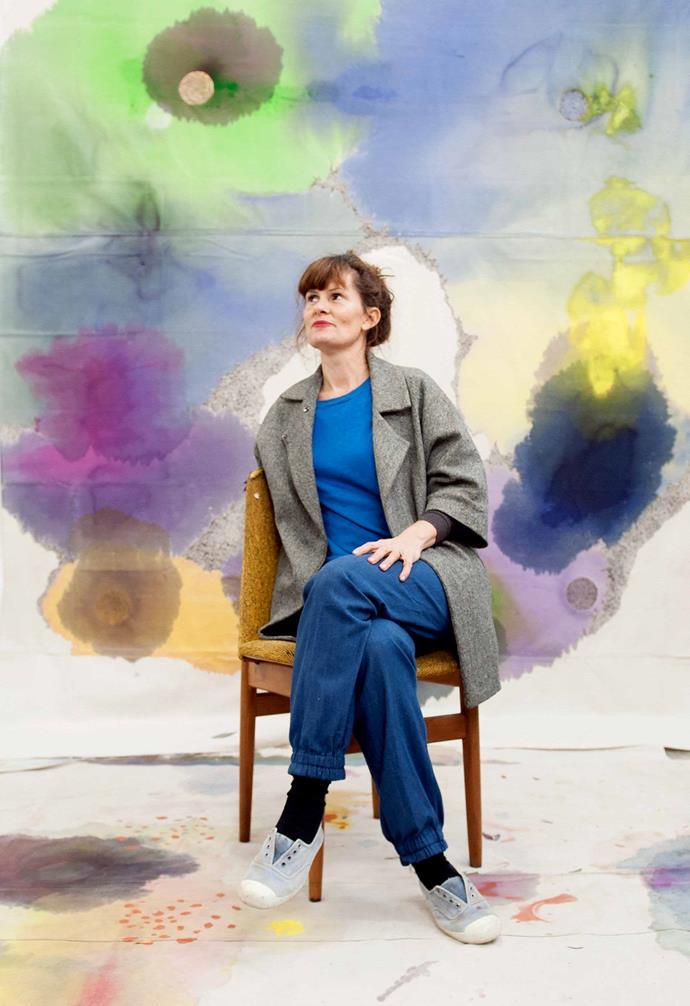 Painter Lara Merrett relaxes in her art studio. *Photography: Carine Thevenau*.