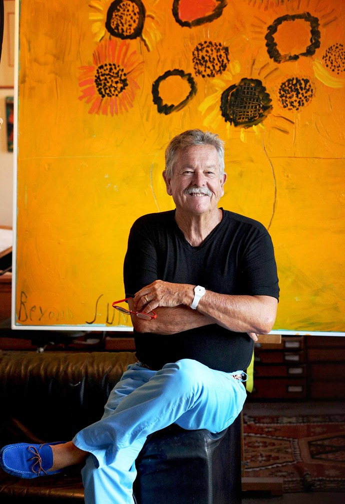 Ken sits in front of his Beyond Sunflowers artwork. *Photography: Stuart Spence*.