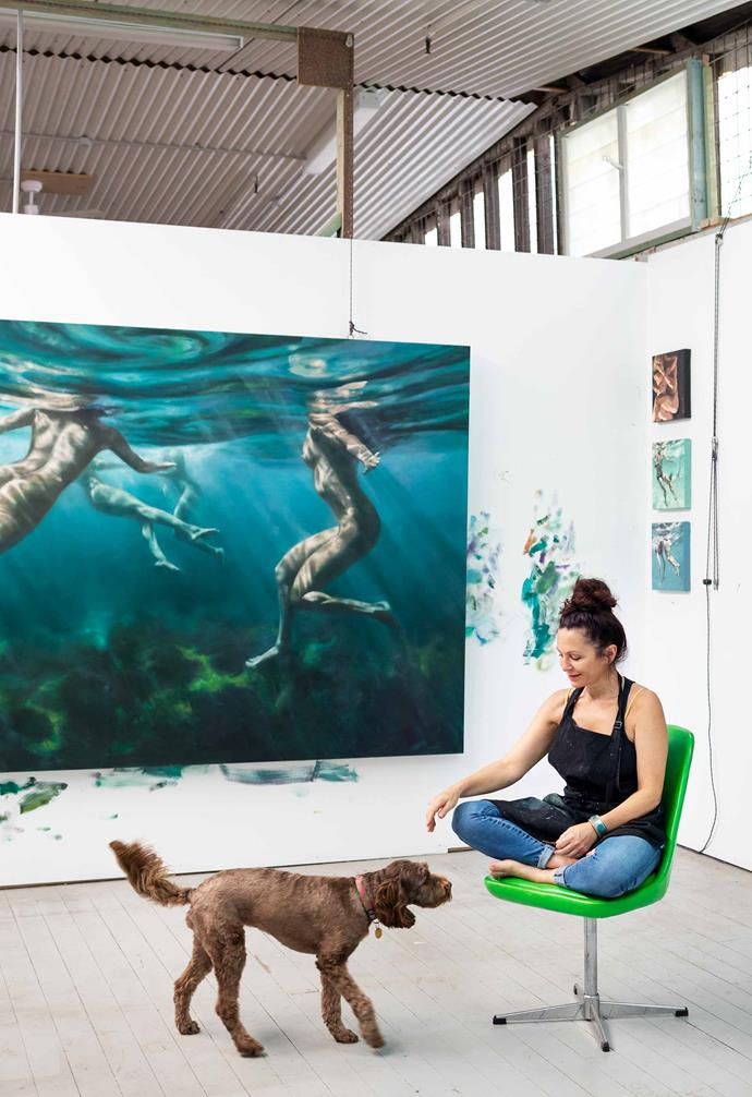 Martine and studio pup Wahlo with her new artworks hung behind. *Photography: Jem Cresswell*.