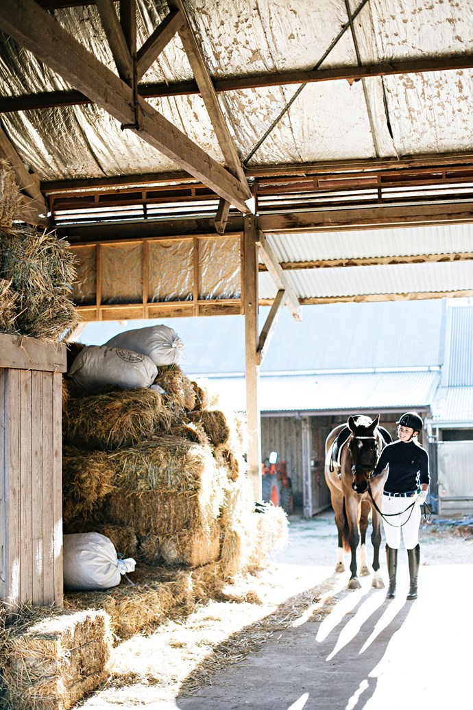 """Izzy, who was seven when the family moved to the area, has since become a keen rider. She and her horse Doug, an eight-year-old brown warmblood, are being [tutored in dressage](https://www.homestolove.com.au/formal-country-garden-14054
