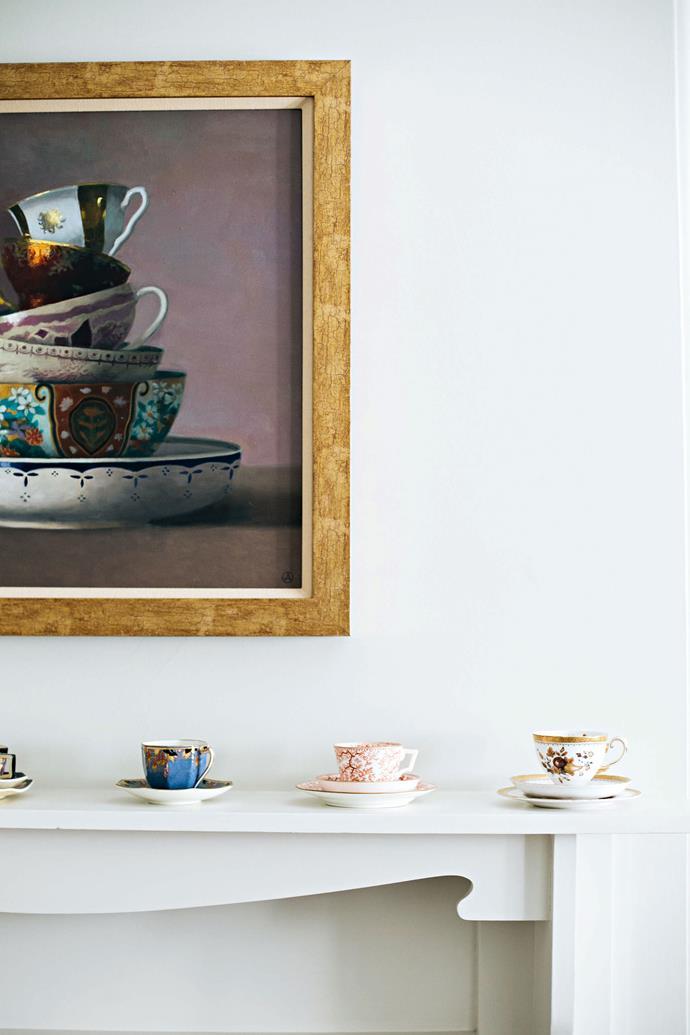 "An artwork by [Olga Antonova](http://olgaantonova.com/|target=""_blank""|rel=""nofollow"") hangs above the mantelpiece where Sarah displays her collection of teacups."