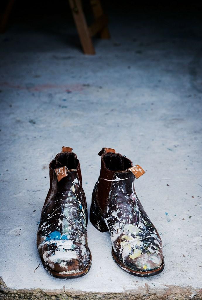 Her paint-splattered boots.