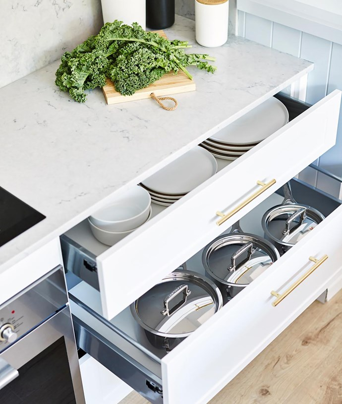Detail of a Freedom Kitchens Essentials flatpack kitchen. Metallic handles add a touch of luxe to the Catherine cabinetry. Caesarstone Noble Grey benchtop.