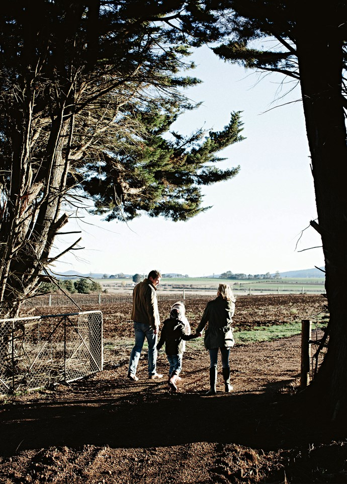 Stewart, William, Amelia and Lucy walk out the gate into the farmland beyond.