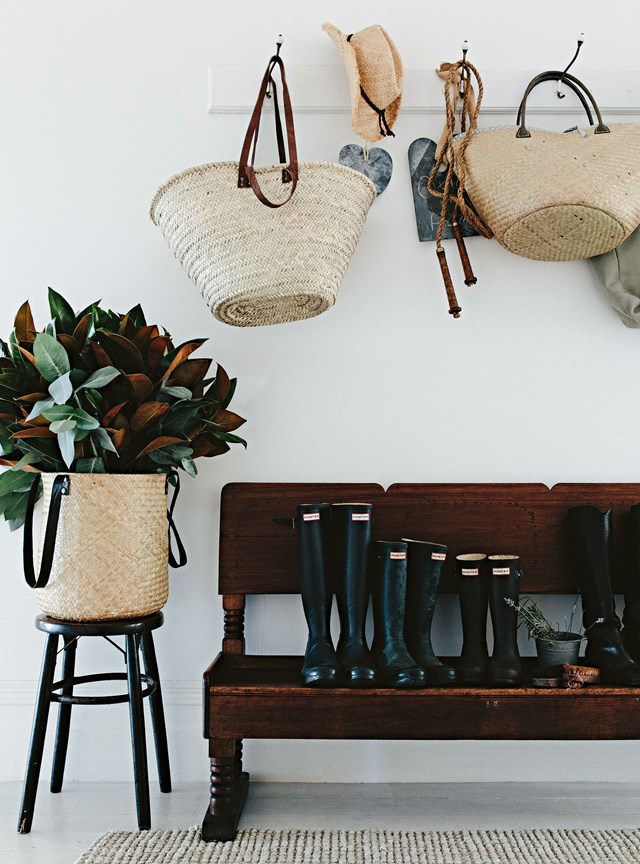 This mudroom is both stylish and functional, decorated with Hunter gumboots lined up and ready for walking out on the farm and baskets used for picking produce.