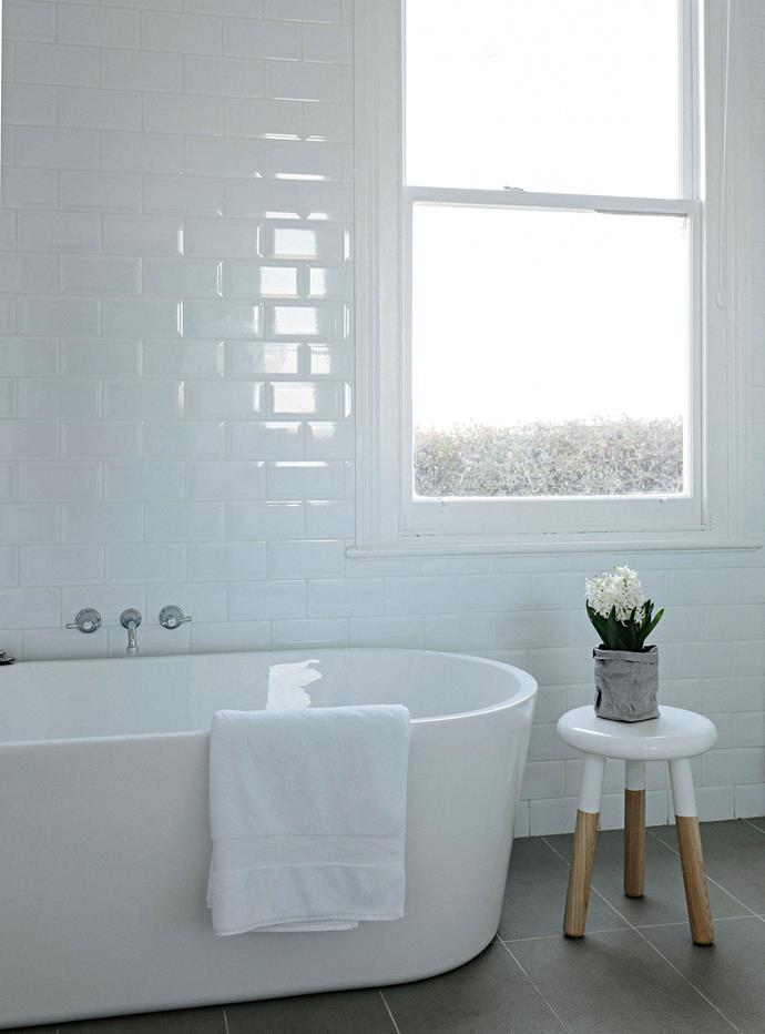 "The bathroom features a deep bath with tapware from Restoration Hardware in New York. The 'Malmo' stool is from [Schots Home Emporium](https://www.schots.com.au/|target=""_blank""