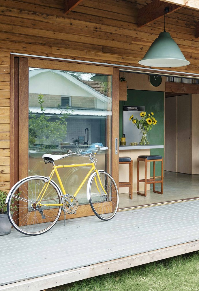 """**Patio** """"We're so lucky with the climate that we can open up the doors and double the size of the house,"""" says Bekk of the Meranti timber-framed sliding glass doors."""