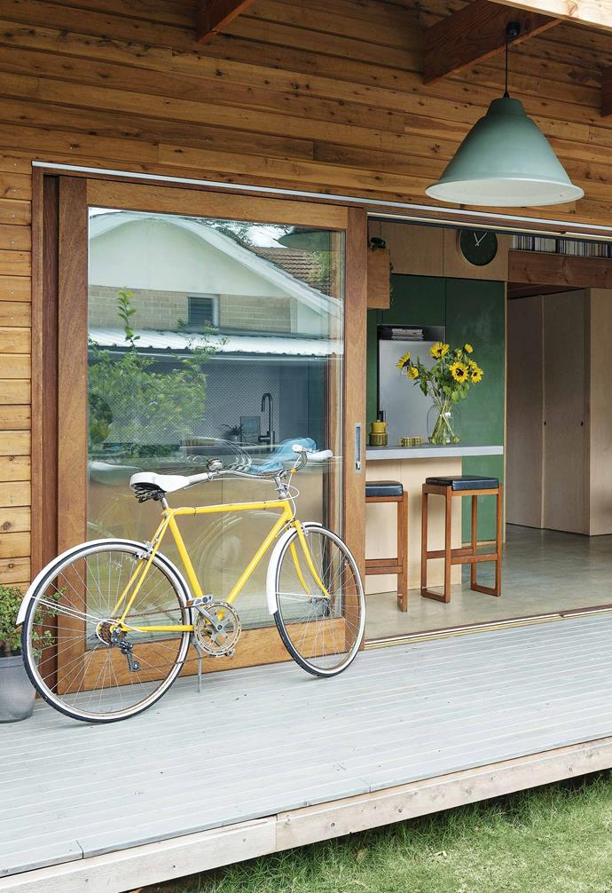 "**Patio** ""We're so lucky with the climate that we can open up the doors and double the size of the house,"" says Bekk of the Meranti timber-framed sliding glass doors."
