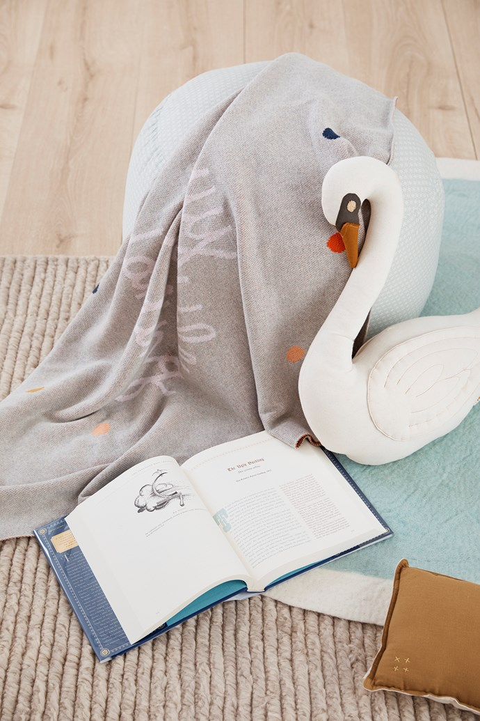 Use affordable decor items like soft toys and books to achieve the theme you're going for.