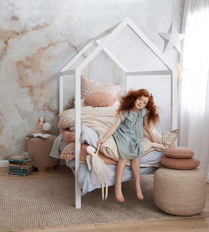 "**The Princess and the Pea**  <br><br> A child's room needs to grow with them, which makes [removable wallpaper](https://www.homestolove.com.au/diy-removable-wallpaper-7041|target=""_blank"") an ideal decorating choice. Meanwhile, a whimsical canopy bed, gauzy curtains and plush poufs and pillows are what little girls' dreams are made of."