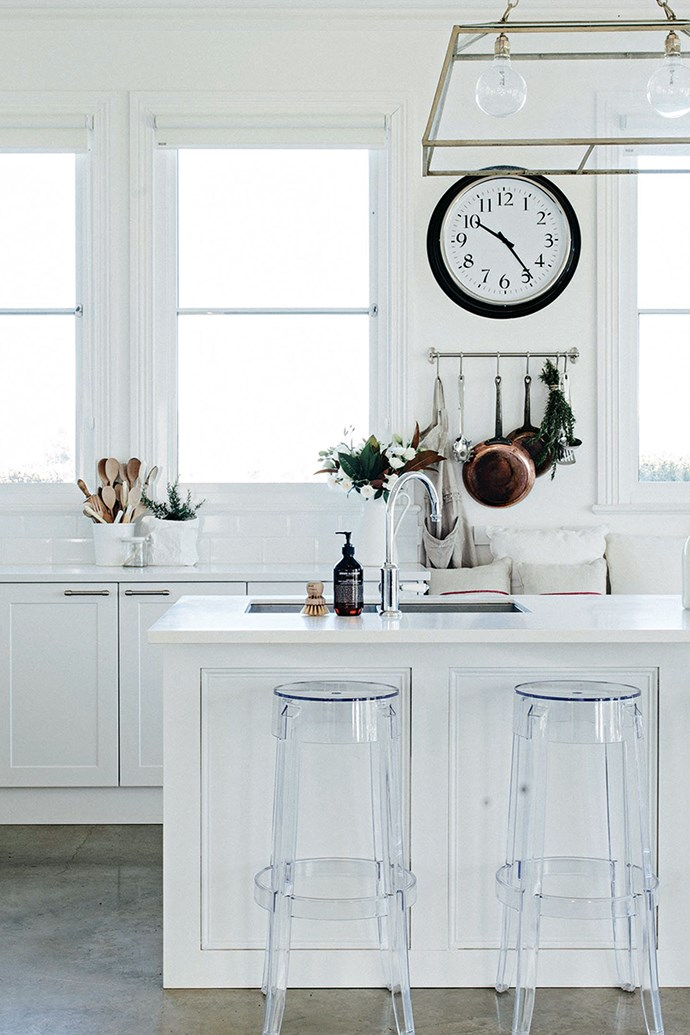 """The new kitchen has a custom-made island bench, cupboards from Bunnings Warehouse, polished concrete floors and a double pendant light from [Cotton Love](https://www.cottonlovehome.com/ target=""""_blank"""" rel=""""nofollow""""). The polycarbonate Philippe Starck 'Charles Ghost' stools by Kartell are from [Space](https://www.spacefurniture.com.au/ target=""""_blank"""" rel=""""nofollow"""")."""