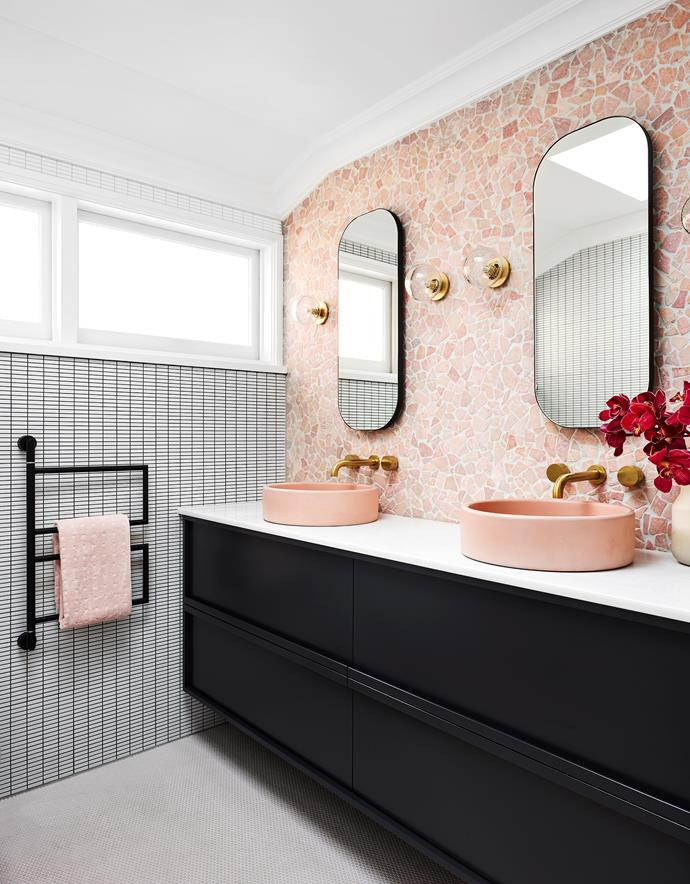 The clients asked designer Lynne Bradley for a double vanity so that they could be comfortable in the bathroom together, with ample space and a sense of personality and style. Noodco 'The Bowl Basin' in Blush Pink from Matt di Costa. Zuster 'Issy Z1' oval mirror with solid American Oak frame in Charcoal from Reece. *Photograph*: Anson Smart. From *Belle* April 2019.