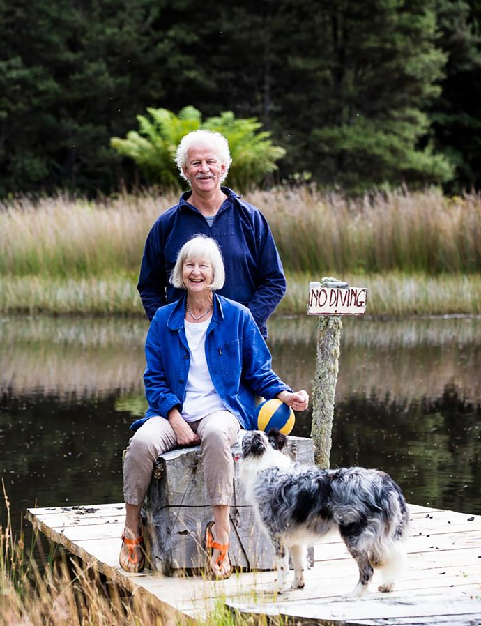 Sally and Andrew with beloved pooch Pearl, on a jetty they built over a spring-fed lake on the property.