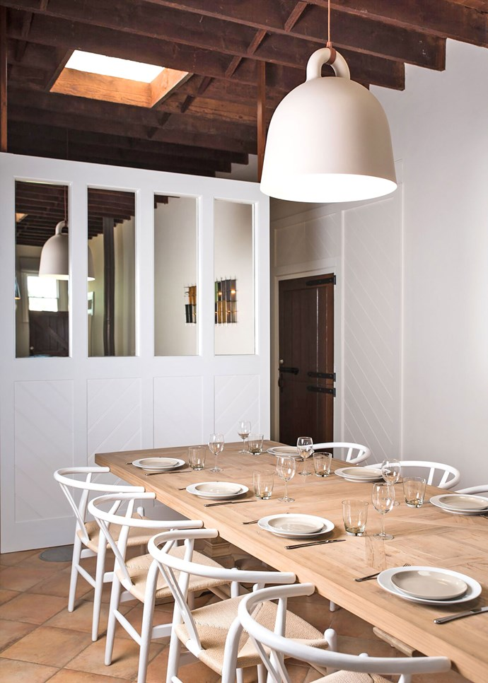 """The Coach House has been decorated in a bright, contemporary style. A 'Bell' pendant light by [Normann Copenhagen](https://fave.co/2G91Sml