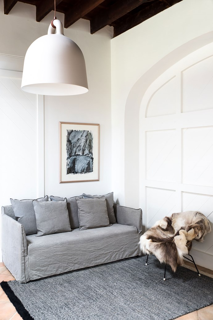 """Layers of texture create a cosy and inviting living space. The 'Joe' linen sofa is from [MCM House](https://mcmhouse.com/product/joe-sofa/